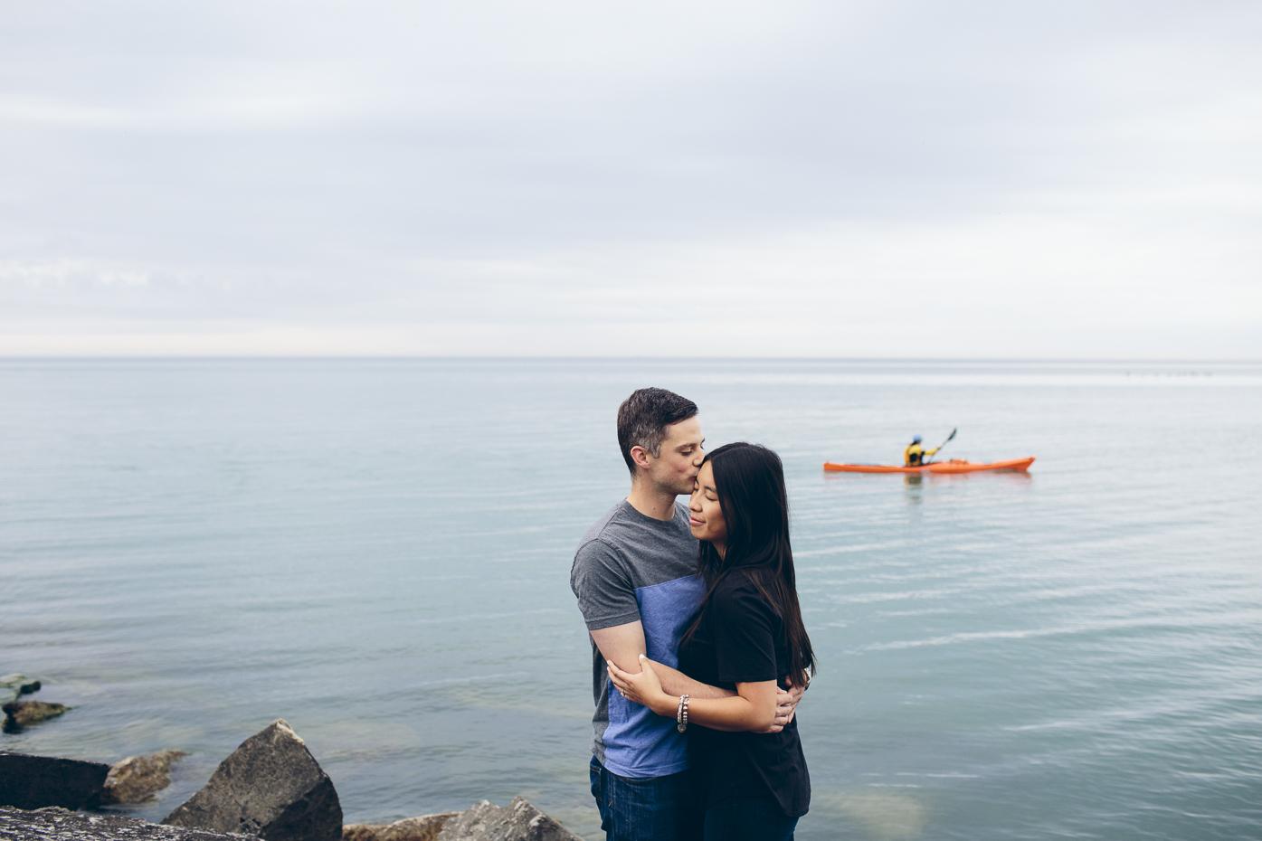 Engaged couple at the Scarborough Bluffs. Toronto, Ontario.