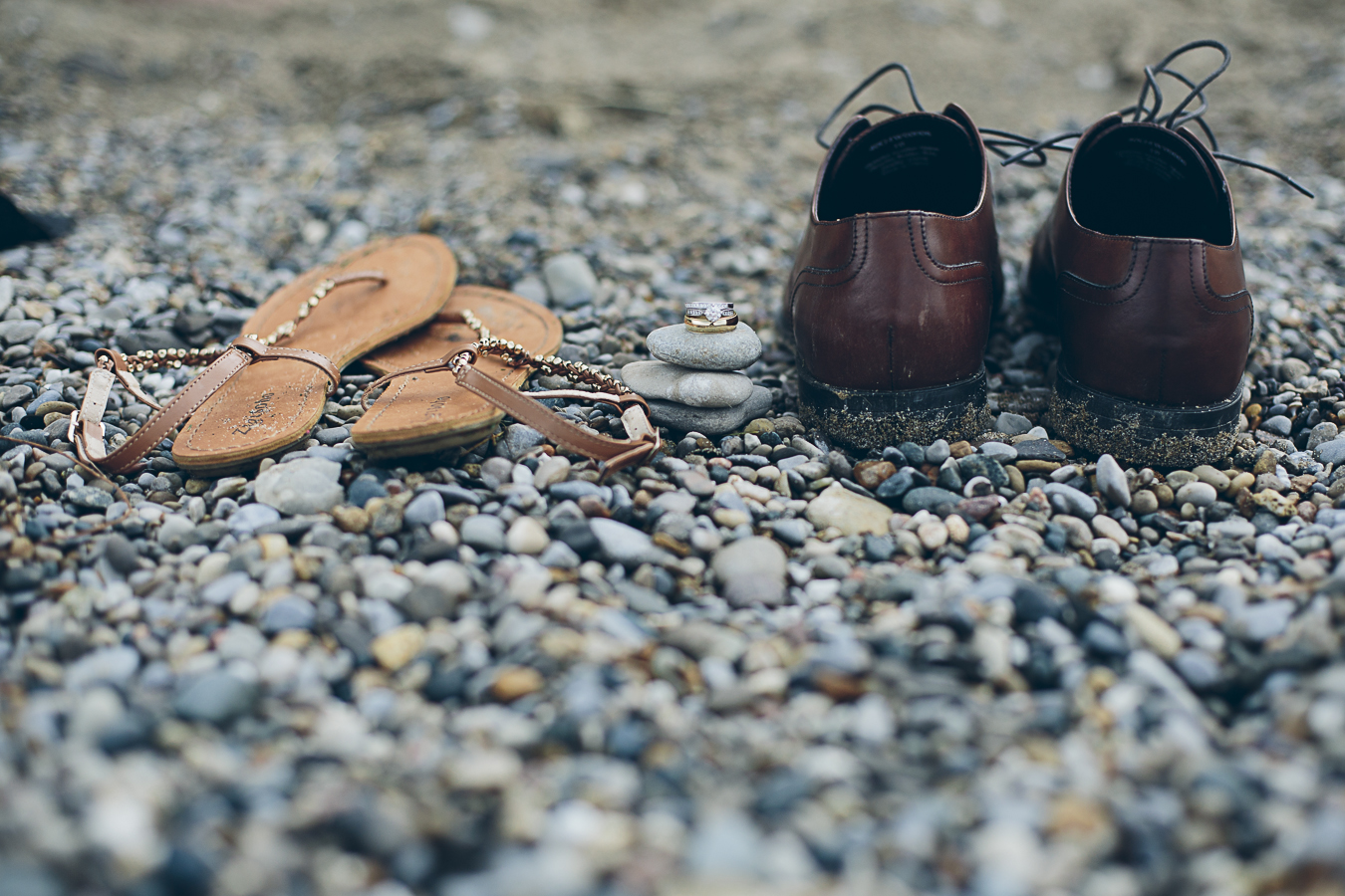 details image of shoes and rings on beach