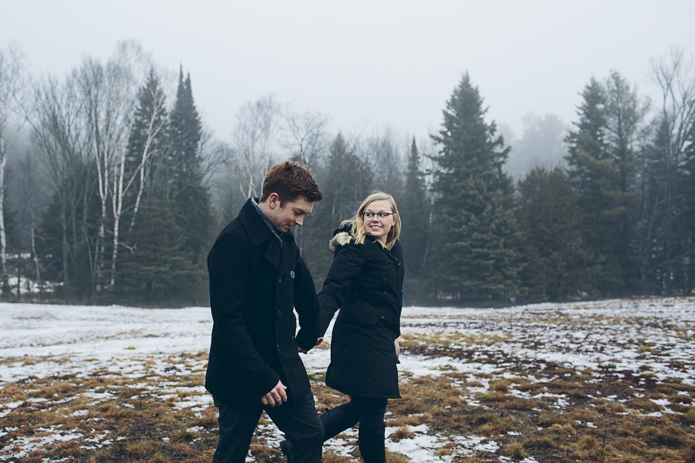 A cute couple in a snowy field
