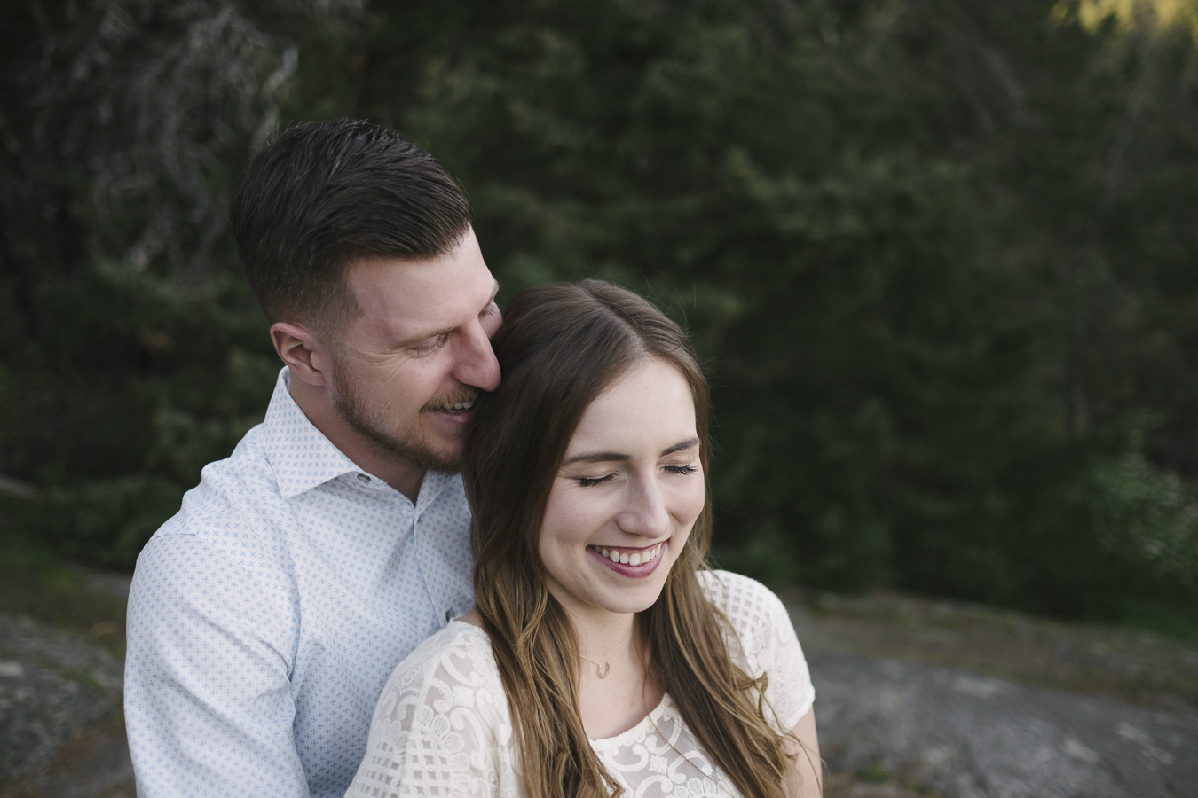 couple giggling during their engagement session