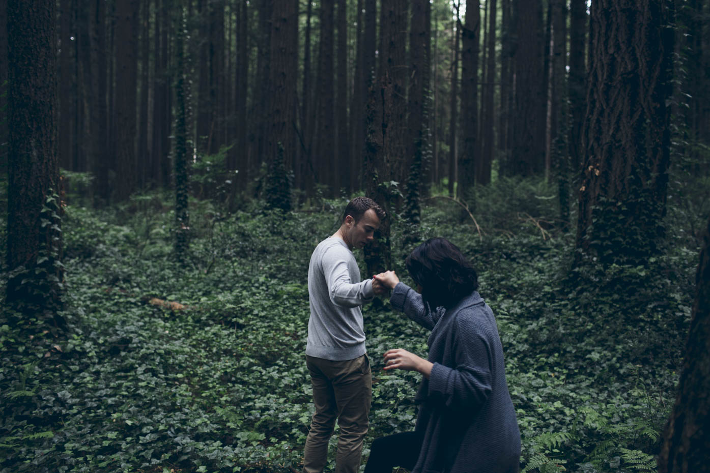 Couple walking through forest. UEL Vancouver