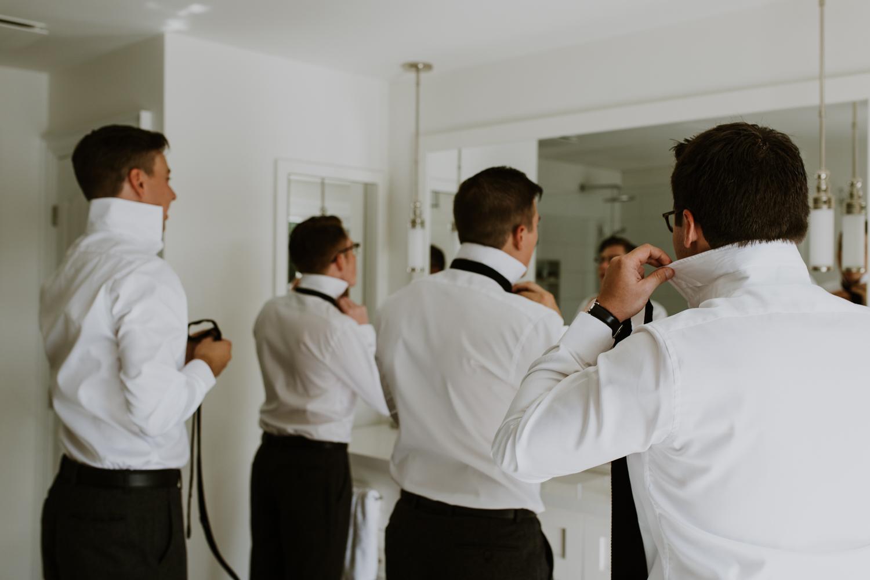 groomsmen getting ready in Muskoka Hunstville cottage