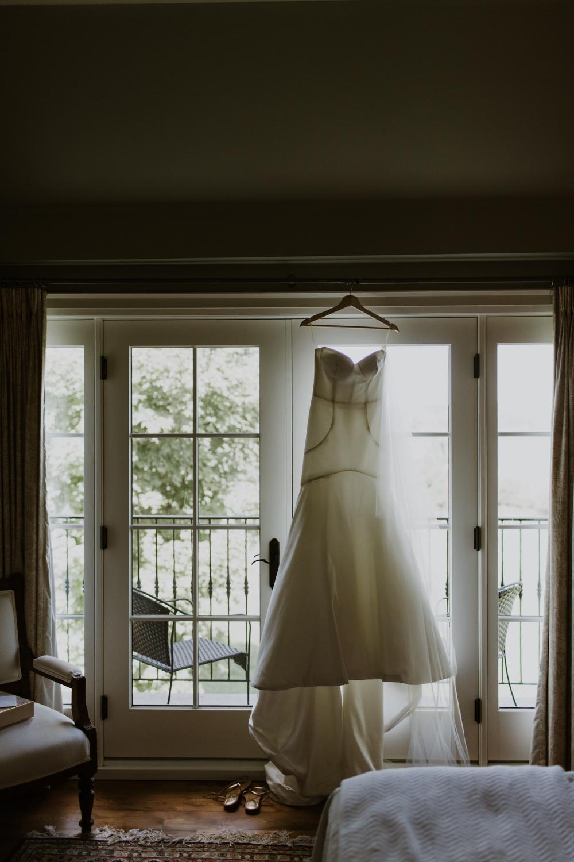 Dress hanging in window of Huntsville cottage