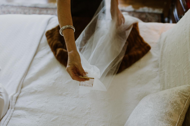 mother holding bridal veil