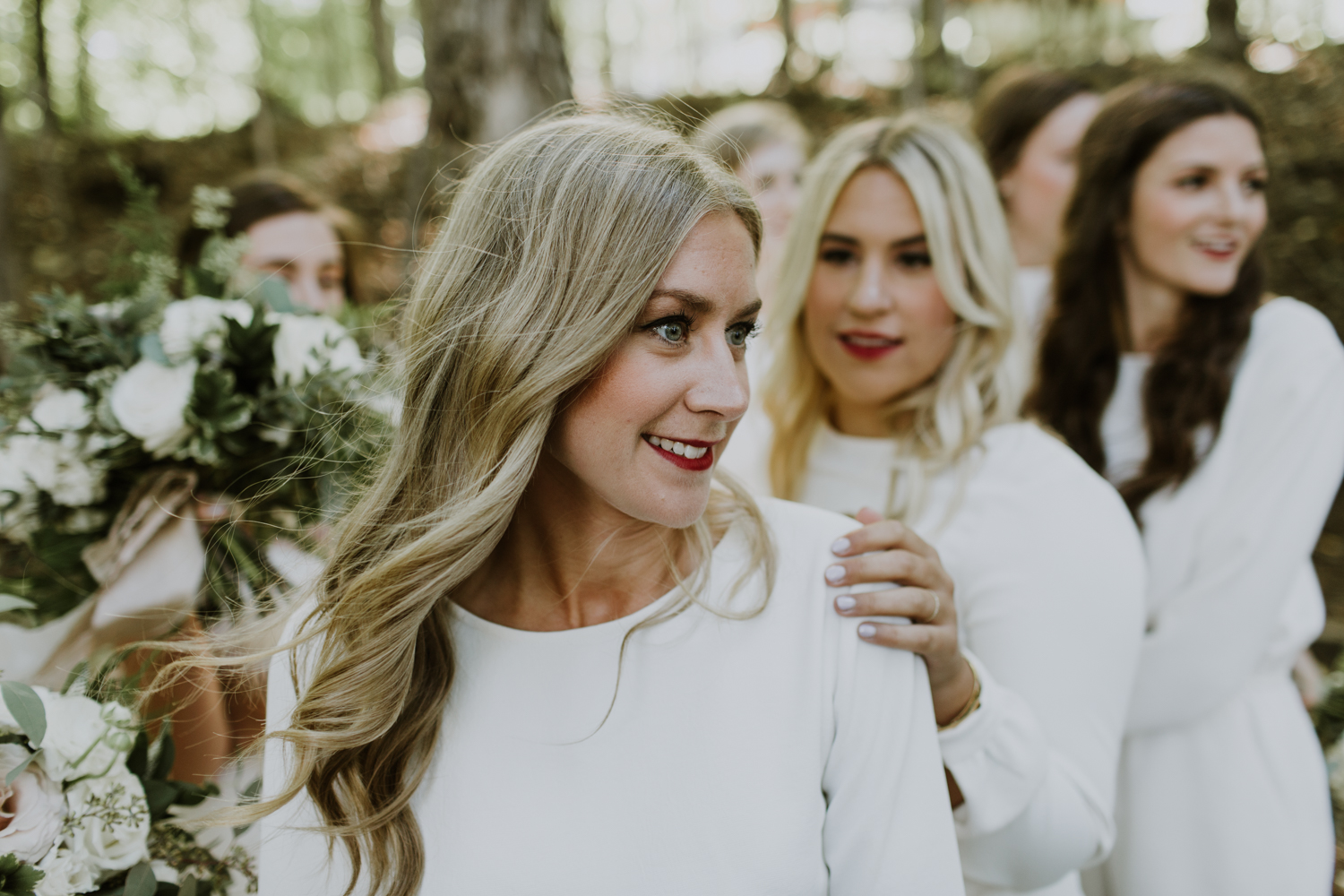 Reds lips on bridesmaid in white
