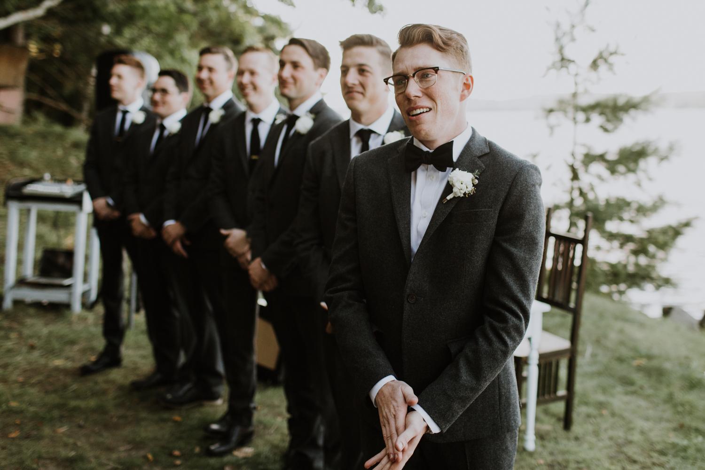 Emotional groom seeing bride