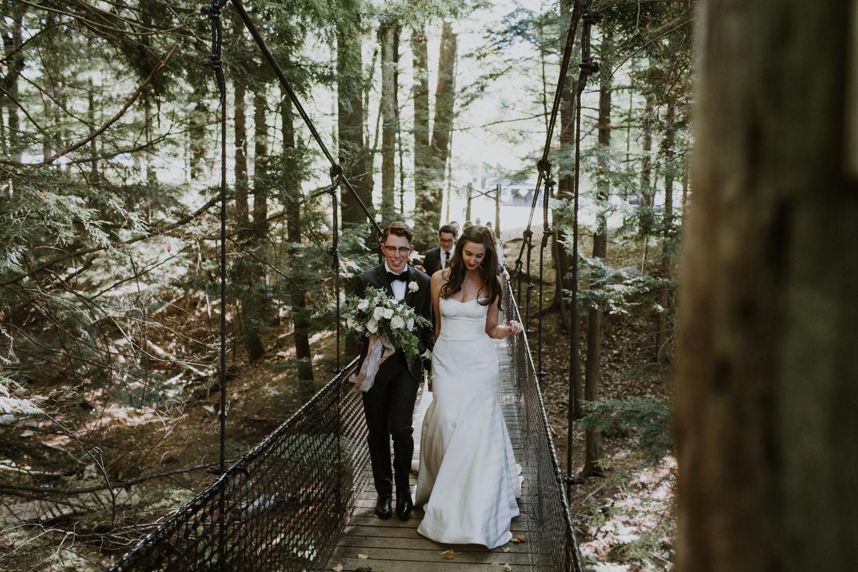 Bride and groom on bridge Muskoka