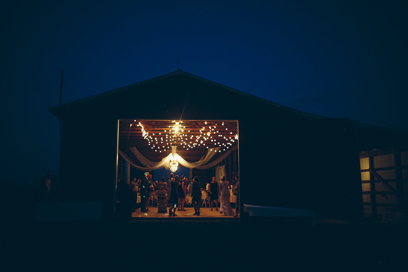 wedding venue. Barn at night with lights inside