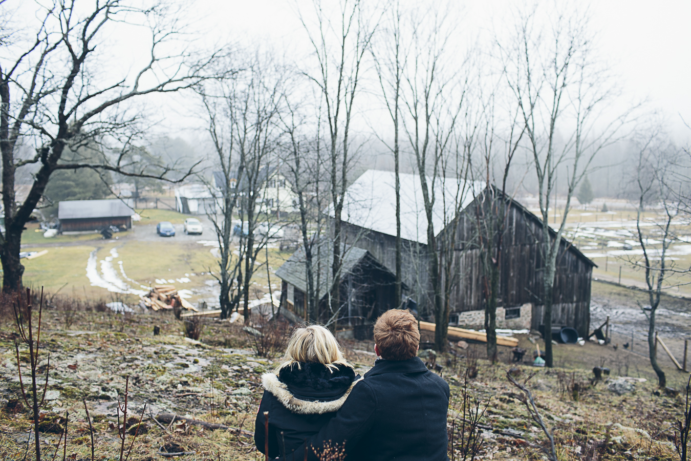young couple looking out over their farm