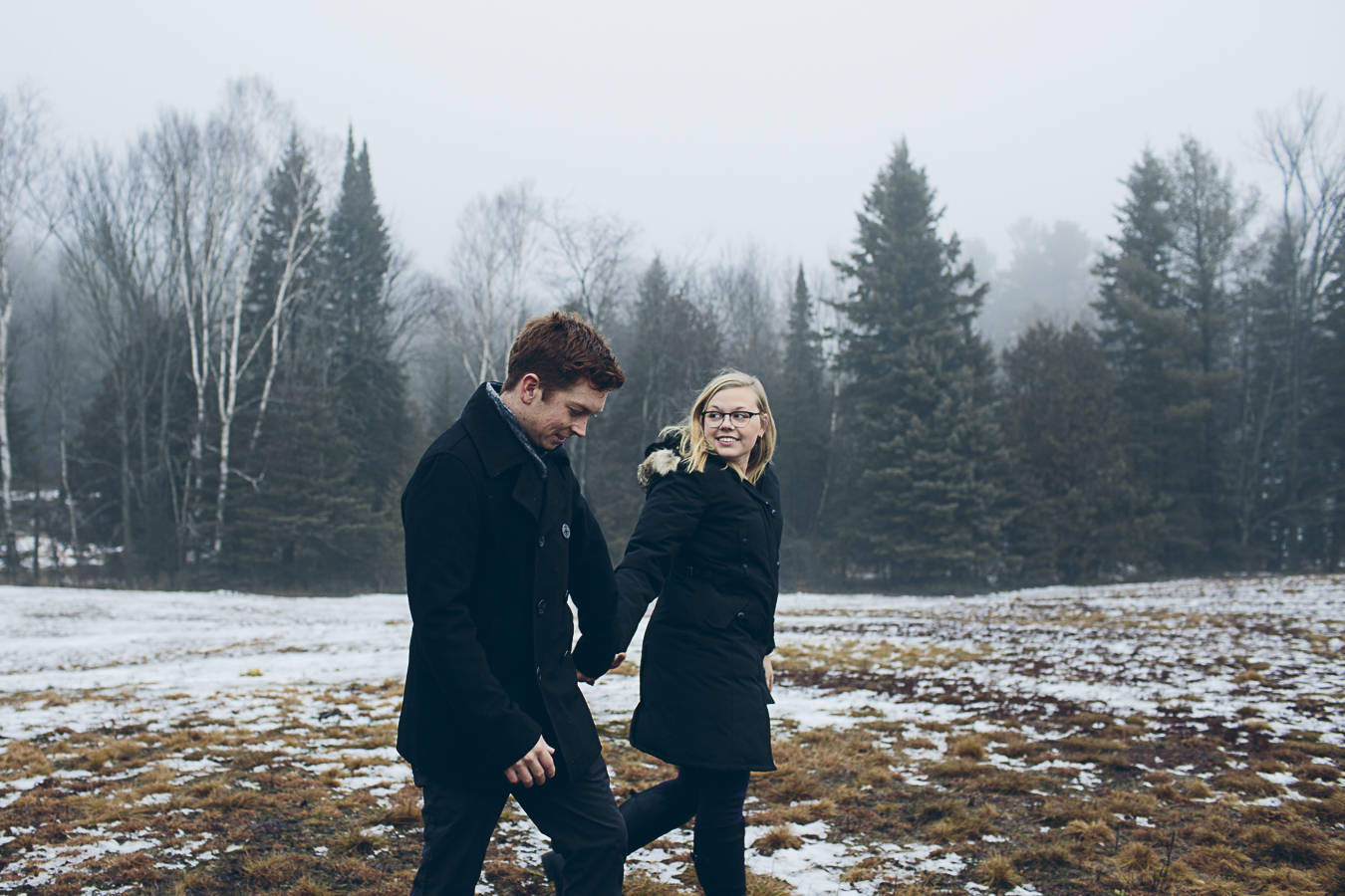 A cute couple in a snowy field