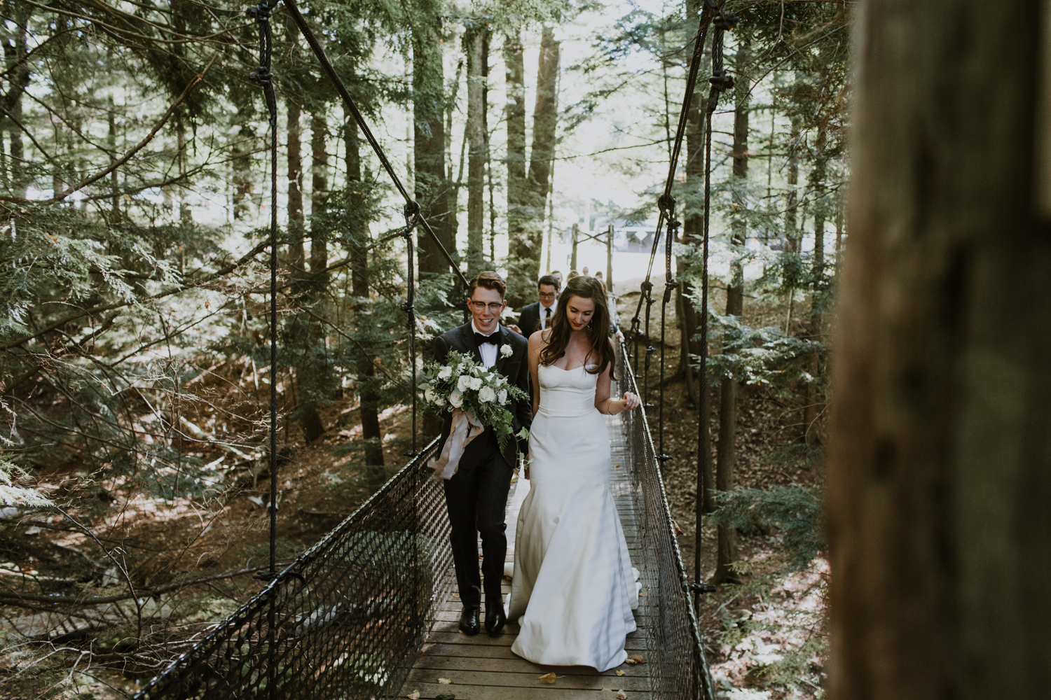 Bride and groom on bridge Muskoka