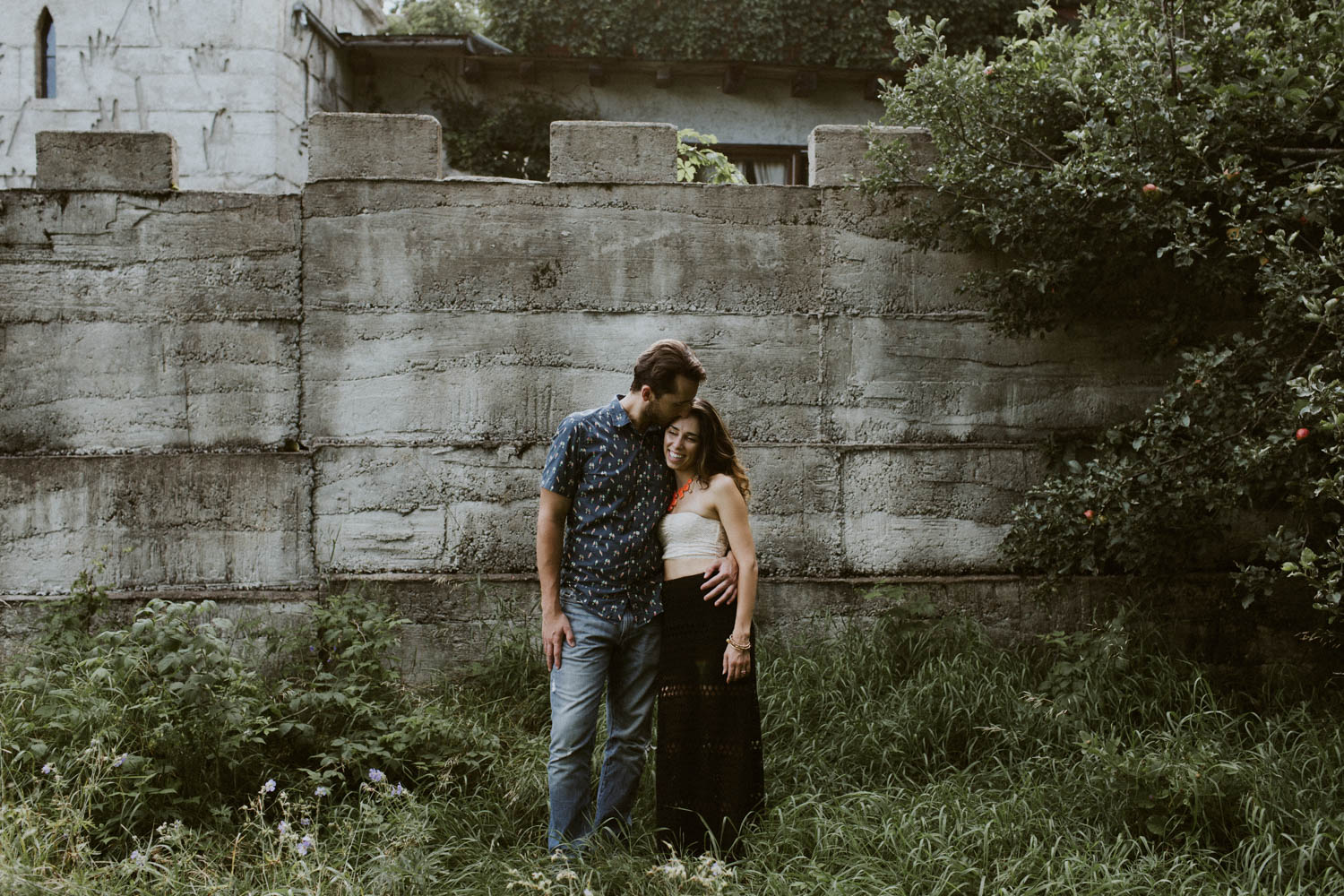 Photographer Engagement at Screaming Heads Muskoka Castle wall