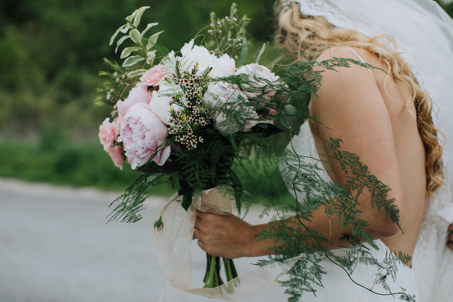 Bride with long veil. Pink & white florals. Balsam Lake Cottage Wedding